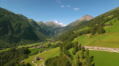 Green village of Heiligenblut in the Alps, aerial footage Stock Footage