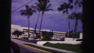 1960: driving past aristocrat and henri hotels in car on paved streets FLORIDA Stock Footage