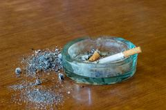 A cigarette in an ashtray Stock Photos
