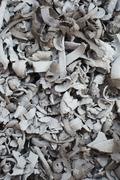 A heap of offcuts curls of clay removed in the process of shaping Stock Photos