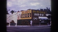 1960: bab-b-q building decorated with rope flags ,has few visitors FLORIDA Stock Footage