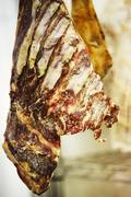 Close up of dry cured meat hanging incharcuterie Stock Photos