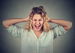 Stressed angry woman yelling screaming has temper tantrum Stock Photos