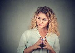 Sneaky, sly, scheming young woman plotting something Stock Photos