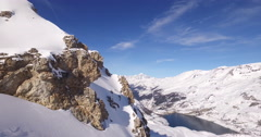Reveal mountains aerial shot with drone shot in France Tignes Stock Footage