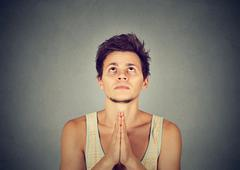 Man praying hands clasped hoping for best asking for forgiveness Stock Photos