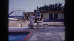 1960: old women at hotel pool beach scene FLORIDA Stock Footage