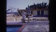 1960: old women at hotel pool beach scene FLORIDA Stock Footage