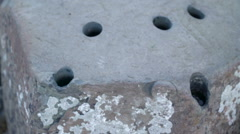 Zoom out view of the big rock with holes Stock Footage