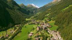 Village of Heiligenblut in the Alps from air Stock Footage