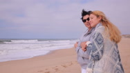 Mature attractive woman and her adult daughter admiring the ocean beach. Stock Footage