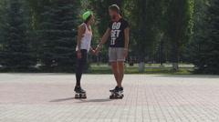 Longboarding, skateboarding, sport in a city park Stock Footage