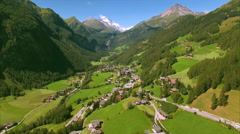 Scenic alpine valley Heiligenblut in the Alps, aerial footage Stock Footage