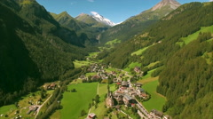 Alpine valley Heiligenblut in the Alps, aerial footage Stock Footage