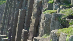 Some of the rock formations in the Giants Causeway Stock Footage