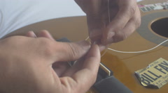 Restringing Your Classical Guitar (turning) bridge 1 Arkistovideo
