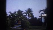 1960: florida palm tree mansion white house front yard gardens FLORIDA Stock Footage