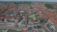 Aerial over harbour lined with historical houses,Volendam,Netherlands Stock Footage