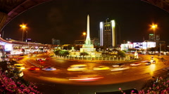 View of the Victory Monument at night in Bangkok Stock Footage