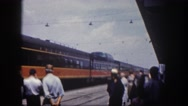 1960: the train station is bustling with people as train approaches  Stock Footage