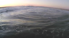 Waves break in the Pacific Ocean at sunset. Stock Footage