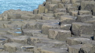 Small square rocks in the sea in Giants Causeway Stock Footage