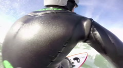 POV 360 swivel of a surfer riding a wave while surfing. Stock Footage
