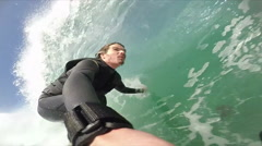 A surfer wipes out while riding a wave while surfing. Stock Footage