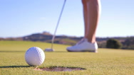 The golfer is trying to get the ball in the hole. Unsuccessful kick. Close Up Stock Footage