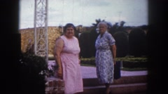 1960: two heavyset older woman standing near festival grounds FLORIDA Stock Footage