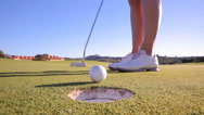 The golfer puts the ball in the hole. Close Up Stock Footage
