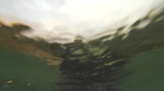 POV of a surfer paddling while surfing to catch a wave. Stock Footage