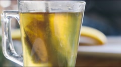 Stirring tea with honey close up 4K stock footage Stock Footage