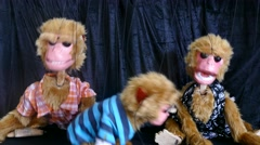 Three monkey marionette Stock Footage