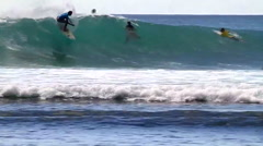A surfer rides a wave while surfing. Stock Footage