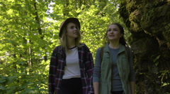 Friends Walk (Toward Camera) Along Paved Hiking Trail In Beautiful Green Forest Stock Footage