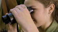 Closeup Of Hiker Using Binoculars Next To Her Friend Stock Footage