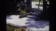 1960: shell shaped pond in the middle of garden FLORIDA Stock Footage