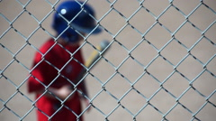 A boy is at bat while playing little league baseball. Stock Footage