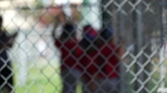 Boys in their dugout during a little league baseball game. Stock Footage