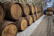 Wine Cellar with oak barrels Stock Photos