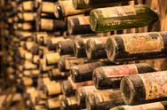 An old wine cellar with old bottles full of red or white wine Stock Photos