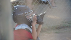 Close-up of a boy playing catcher for a little league baseball team. Stock Footage