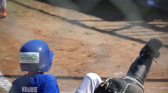 Boys trip and fall backwards playing little league baseball Stock Footage