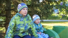 Children have fun looking at soap bubbles in the Park Stock Footage