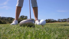 """The golfer uses the putter """"wood"""" for long-range strike. Close Up. Stock Footage"""