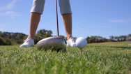 The golfer uses the putter