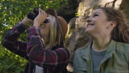 Young Women Enjoy Sharing Binoculars And Searching The Forest For Wildlife Stock Footage