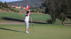 Attractive Mature woman plays Golf at the country club. Stock Footage