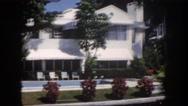 1960: wealthy florida palm tree laden tropical lifestyle on harbors edge FLORIDA Stock Footage